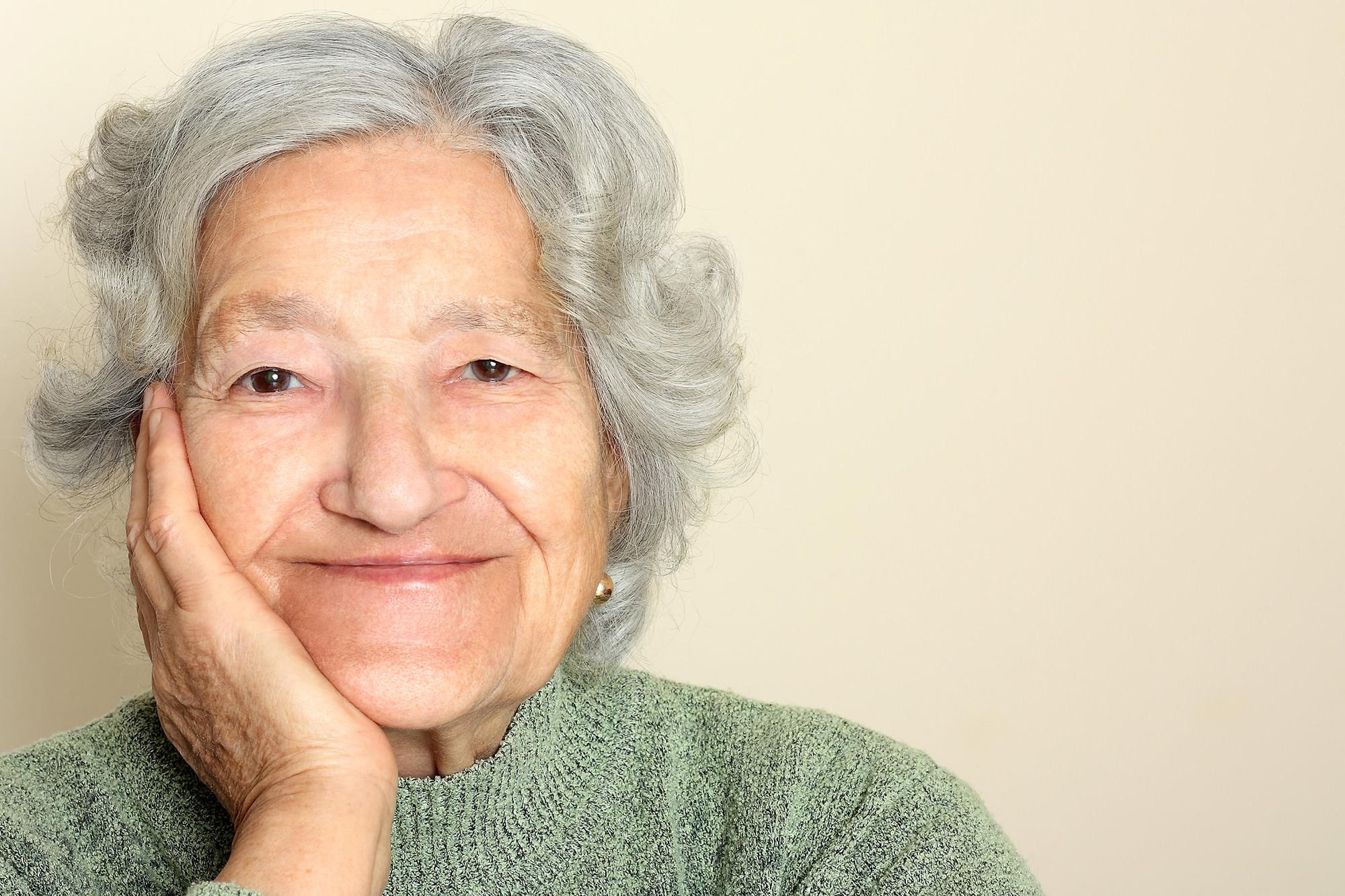 older woman smiling looking at camera