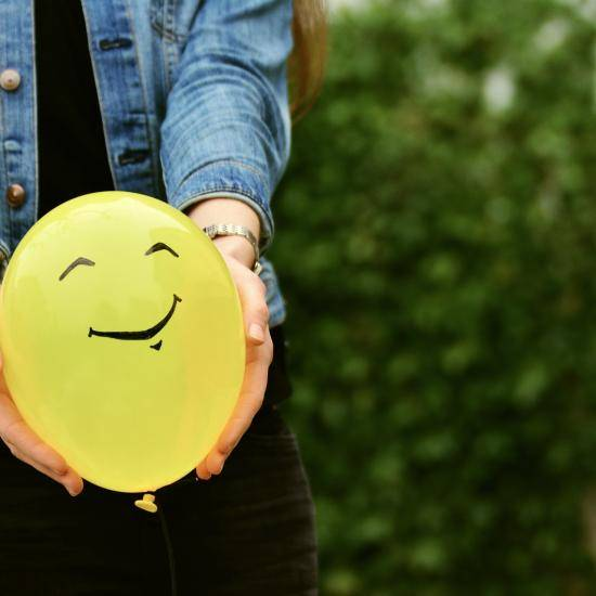 Yellow balloon with a smiley face