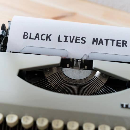 Image of 'Black Lives Matter' typed on paper by Markus Winkler from Pixabay
