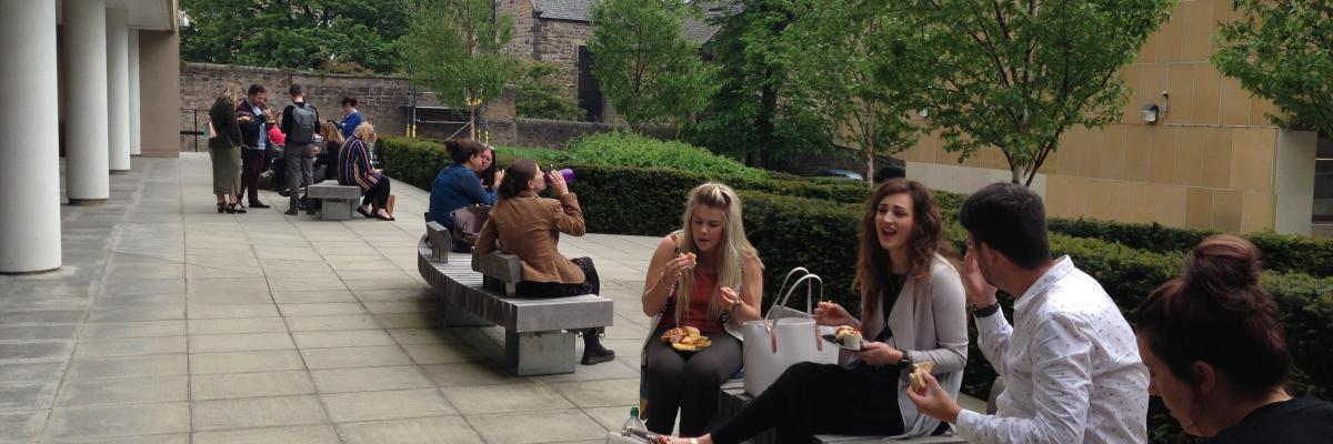 Students sitting having lunch outside