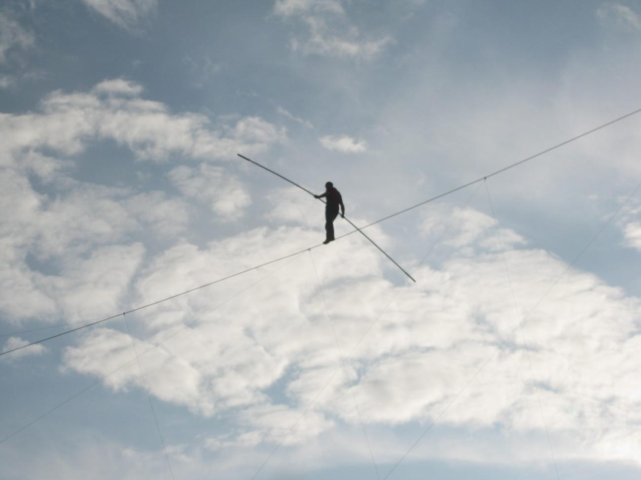 Person on tightrope