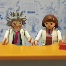 Toy scientists in fake lab