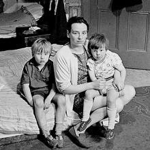 Mother living with her children in an overcrowded single end tenement flat Glasgow